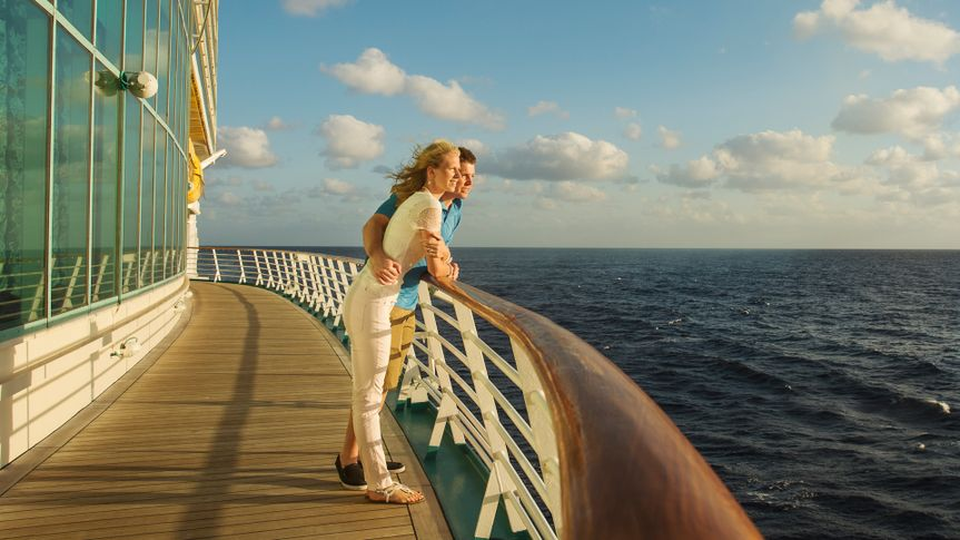 Caucasian couple admiring view from boat deck.