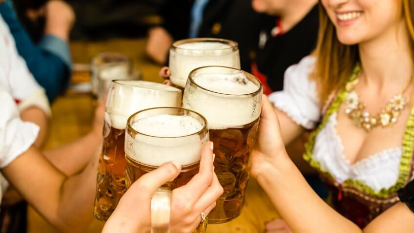 people toasting with beer for oktoberfest