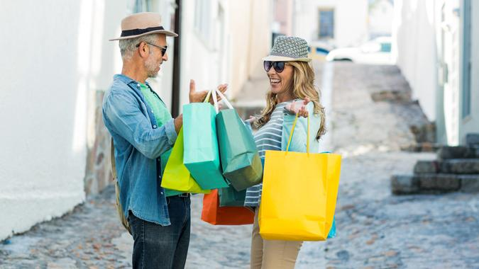 Happy mature couple shopping.