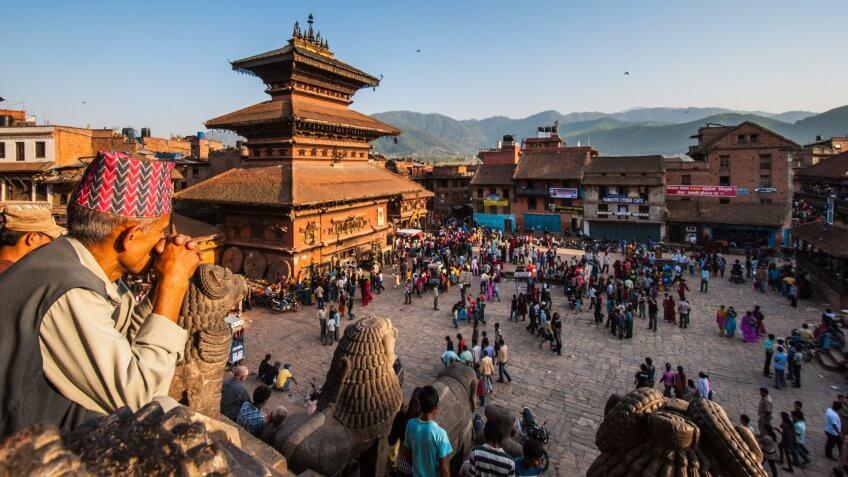KATHMANDU, NEPAL-APRIL 14: Crowding of local Nepalese people visit the famous square of Bhaktapur on April 14, 2010 in Kathmandu, Nepal.