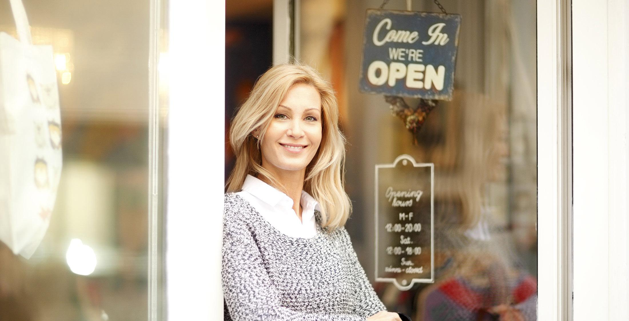 woman in front of shop