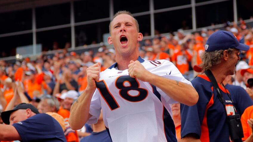 DENVER, CO - SEPTEMBER 23:  A fan supports the Denver Broncos in a quarterback Peyton Manning #18 of the Denver Broncos jersey as they face the Houston Texans at Sports Authority Field at Mile High on September 23, 2012 in Denver, Colorado.