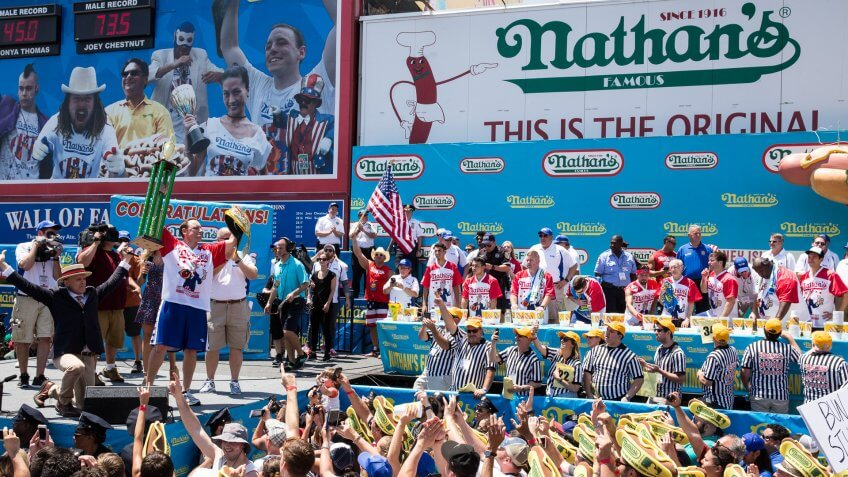 NEW YORK, NY - JULY 04: Joey Chestnut (L) is declared the winner of the 2017 Nathan's Famous International Hot Dog Eating Contest for this 10th title overall after eating 72 hot dogs in 10 minutes at Coney Island on July 4, 2017 in the Brooklyn borough of New York City.