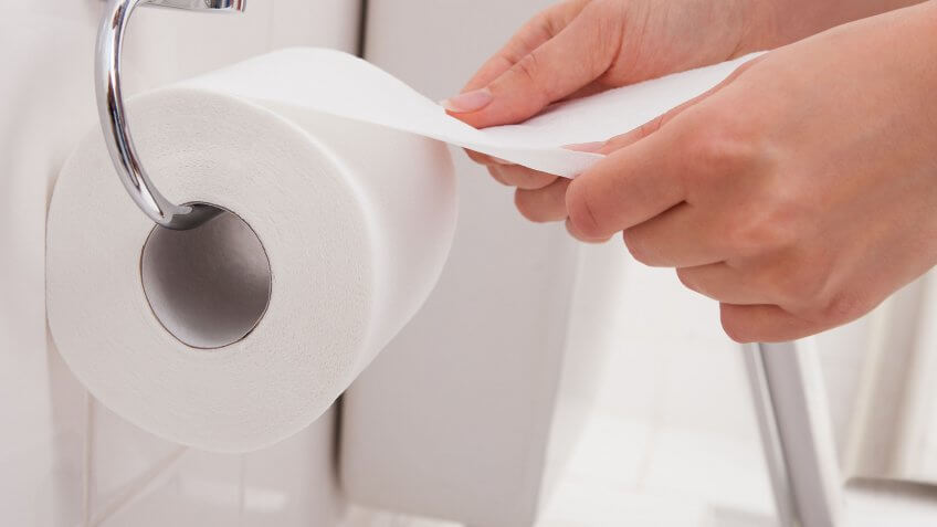 hands pulling toilet paper