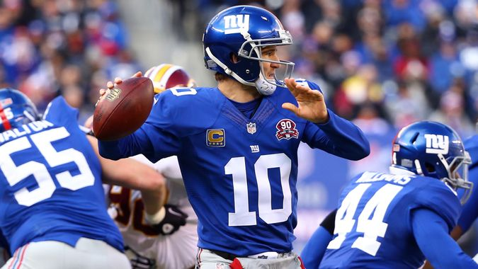 EAST RUTHERFORD, NJ - DECEMBER 14:   Eli Manning #10 of the New York Giants throws a pass in the first half against the Washington Redskins during their game at MetLife Stadium on December 14, 2014 in East Rutherford, New Jersey.