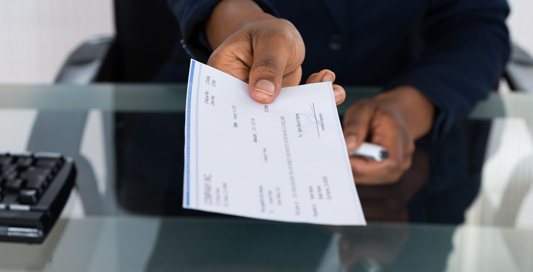 person handing over a check