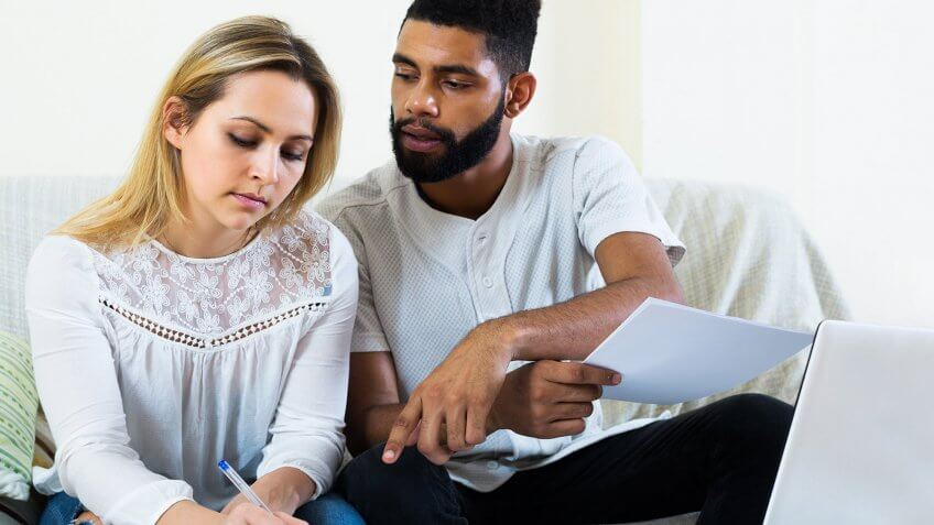 couple looking over bank account statements