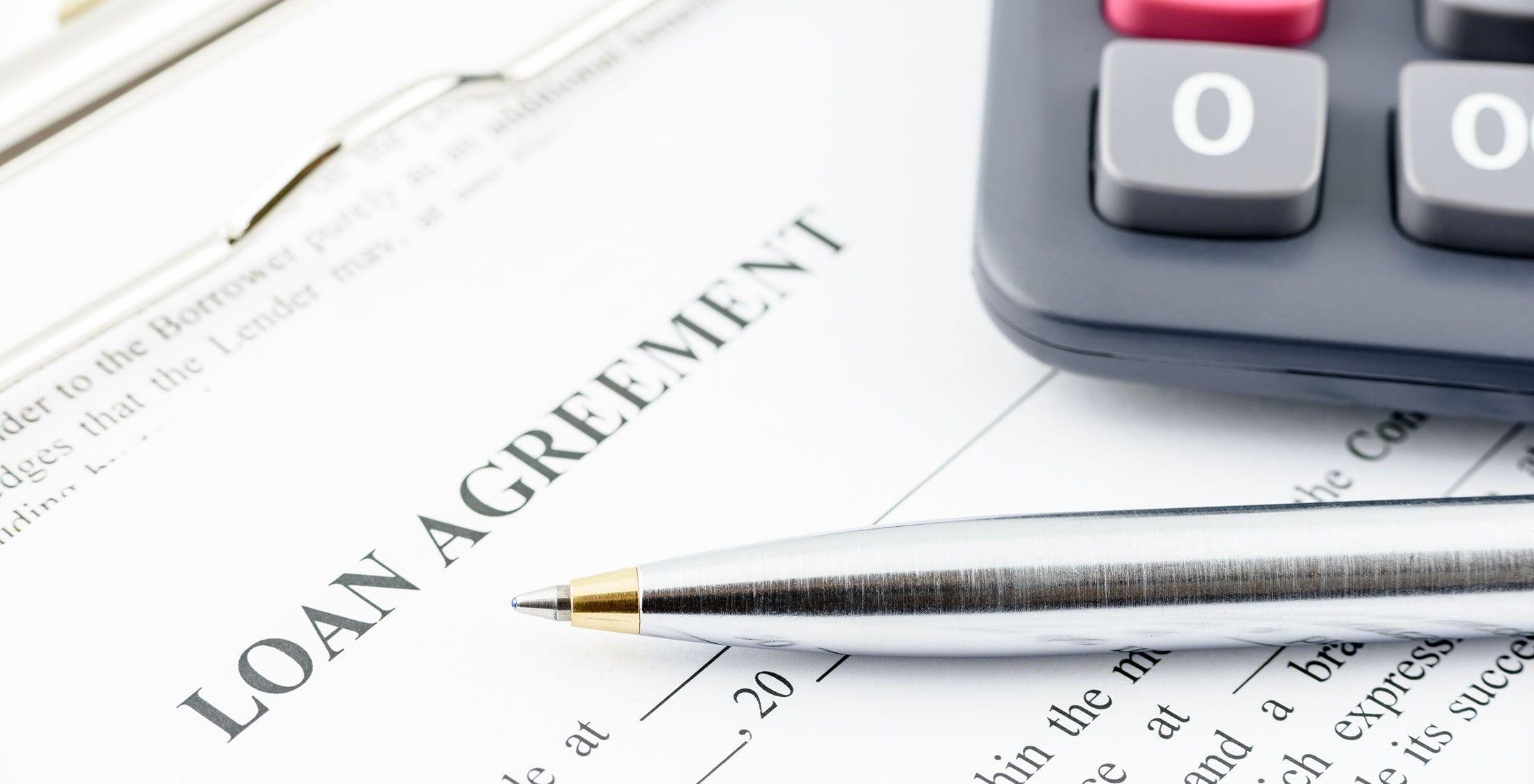 pen on loan agreement form