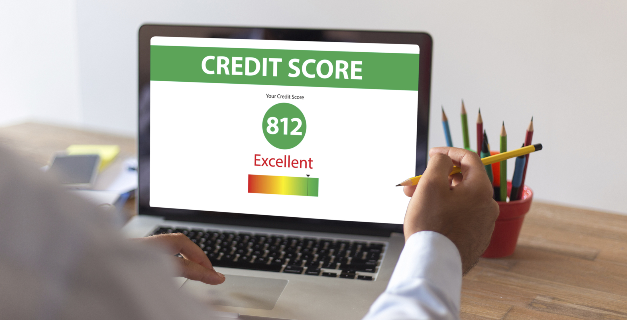 Businessman Checking Credit Score on Internet