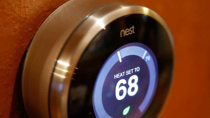 PROVO, UT - JANUARY 16: In this photo illustration, a Nest thermostat installed in a home is seen on January 16, 2014 in Provo, Utah.