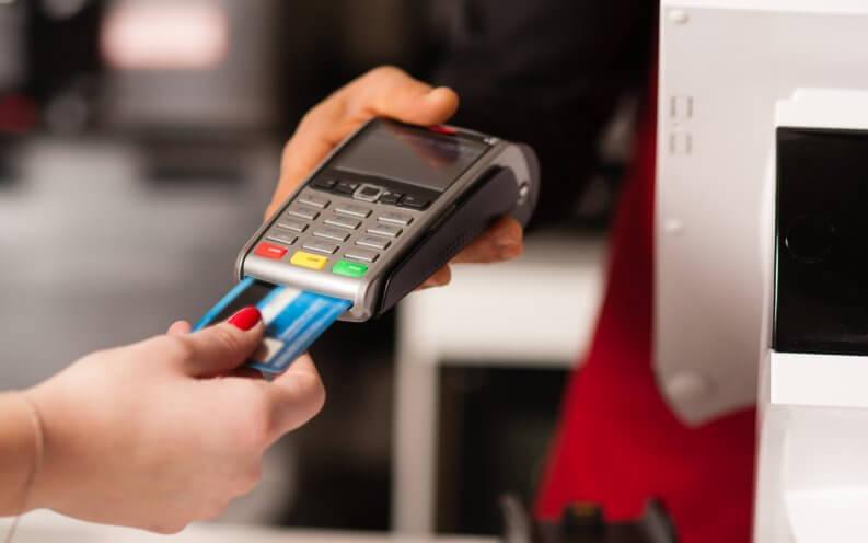 hands scanning credit card