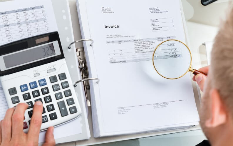 man calculating invoices