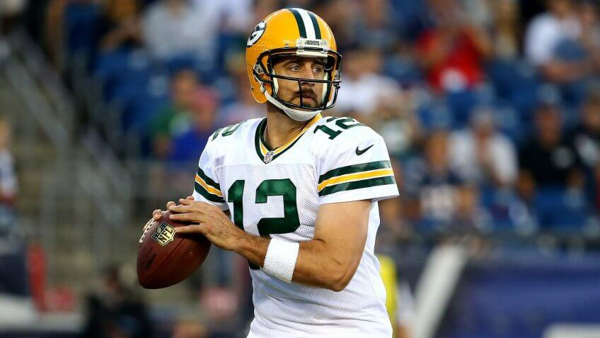 FOXBORO, MA - AUGUST 13:  Aaron Rodgers #12 of the Green Bay Packers drops back to pass in the first quarter against the New England Patriots during a preseason game at Gillette Stadium on August 13, 2015 in Foxboro, Massachusetts.