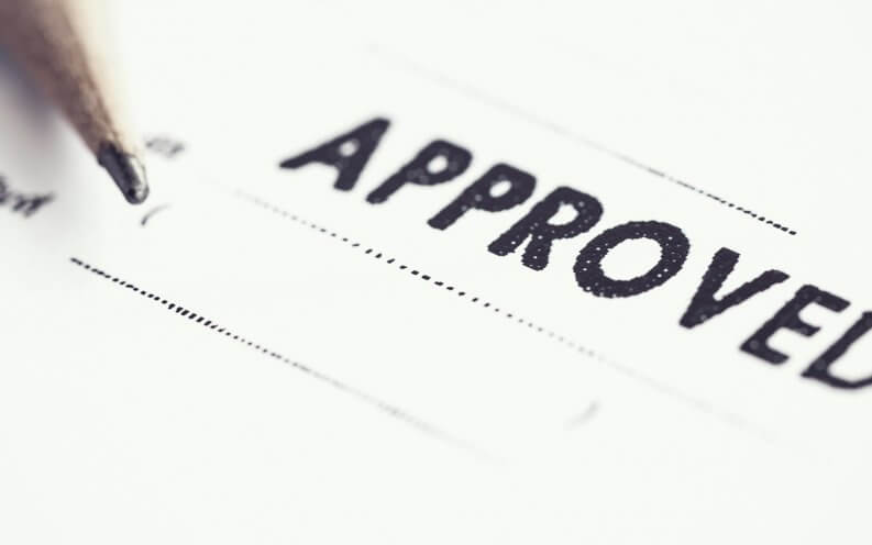 approved stamp on paper