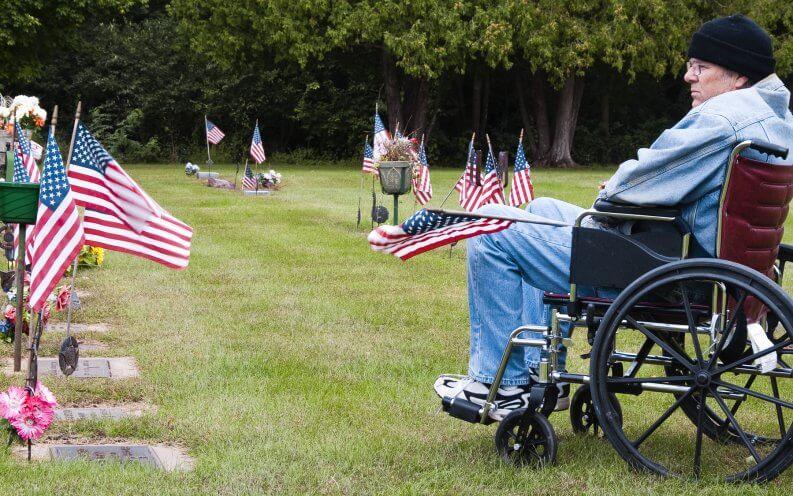 veteran in wheelchair visiting memorial