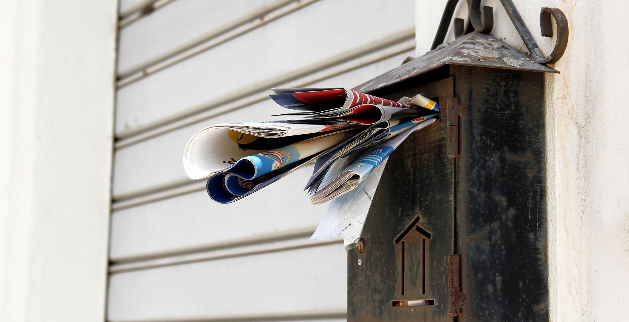 mail bursting through mail slot