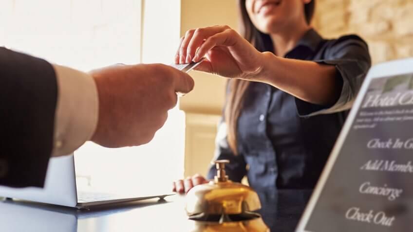 concierge handing card to businessman