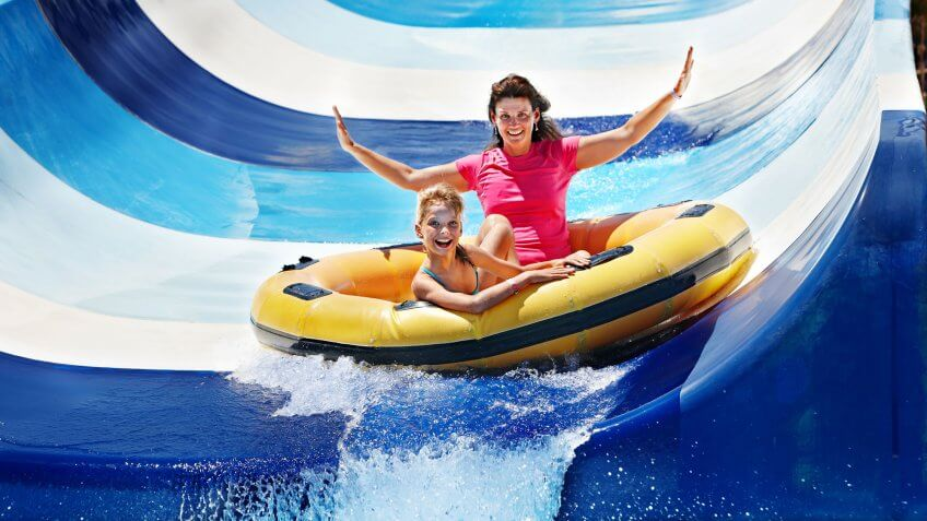 woman and girl in water park raft slide
