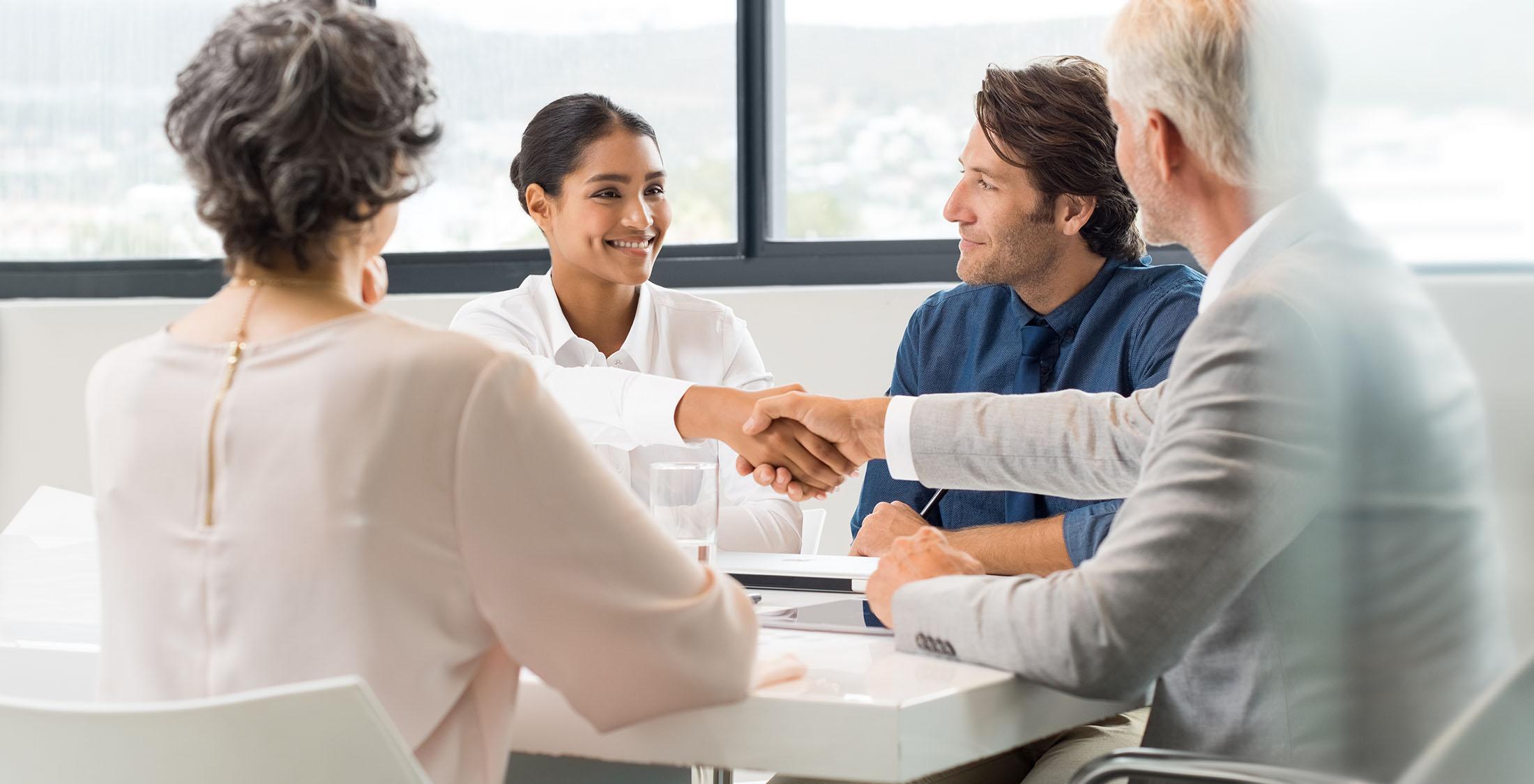 businesswoman shaking businessman's hand