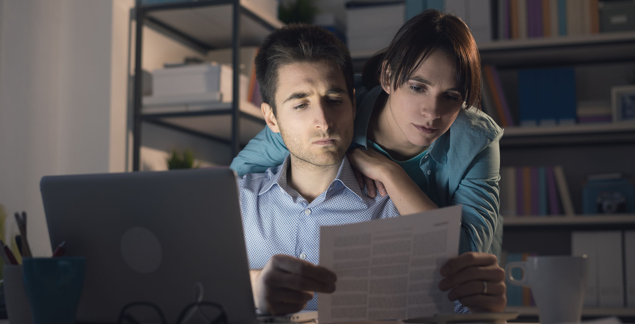 stressed couple looking at credit score