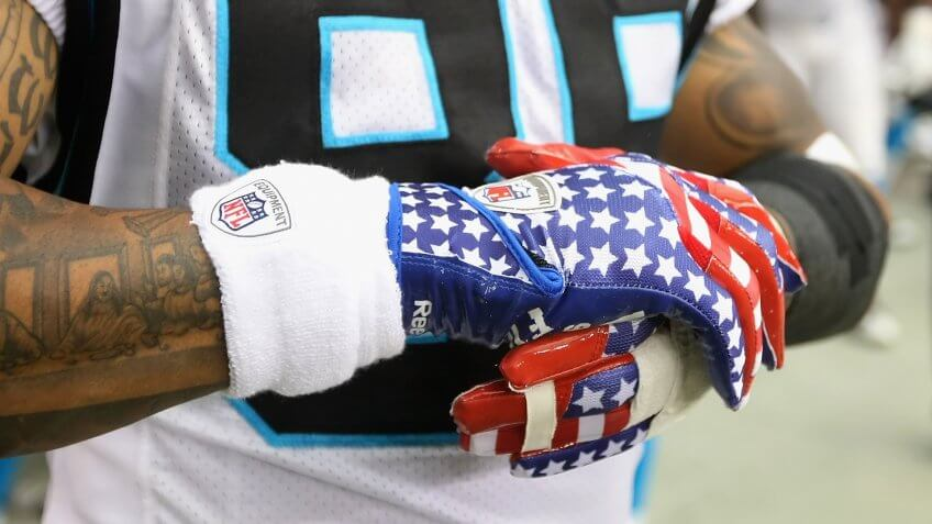 GLENDALE, AZ - SEPTEMBER 11:  Detail of American flag themed gloves worn by wide receiver Steve Smith #89 of the Carolina Panthers during the NFL season opening game against the Arizona Cardinals at the University of Phoenix Stadium on September 11, 2011 in Glendale, Arizona.
