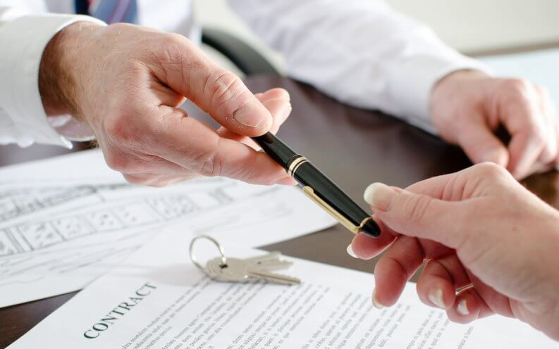 woman signing home contract
