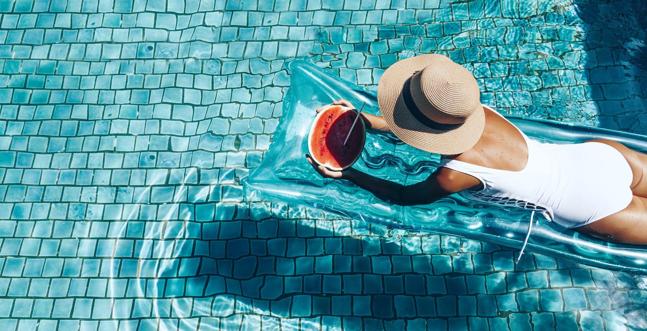 woman on raft in swimming pool