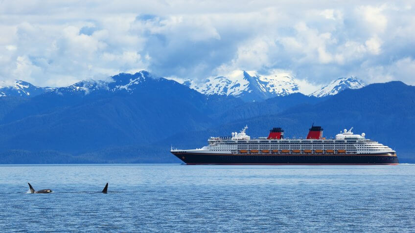 Alaskan cruise liner against a mountainous backdrop