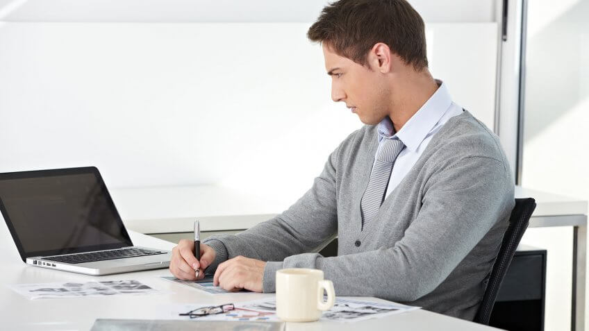 male employee drawing from computer screen