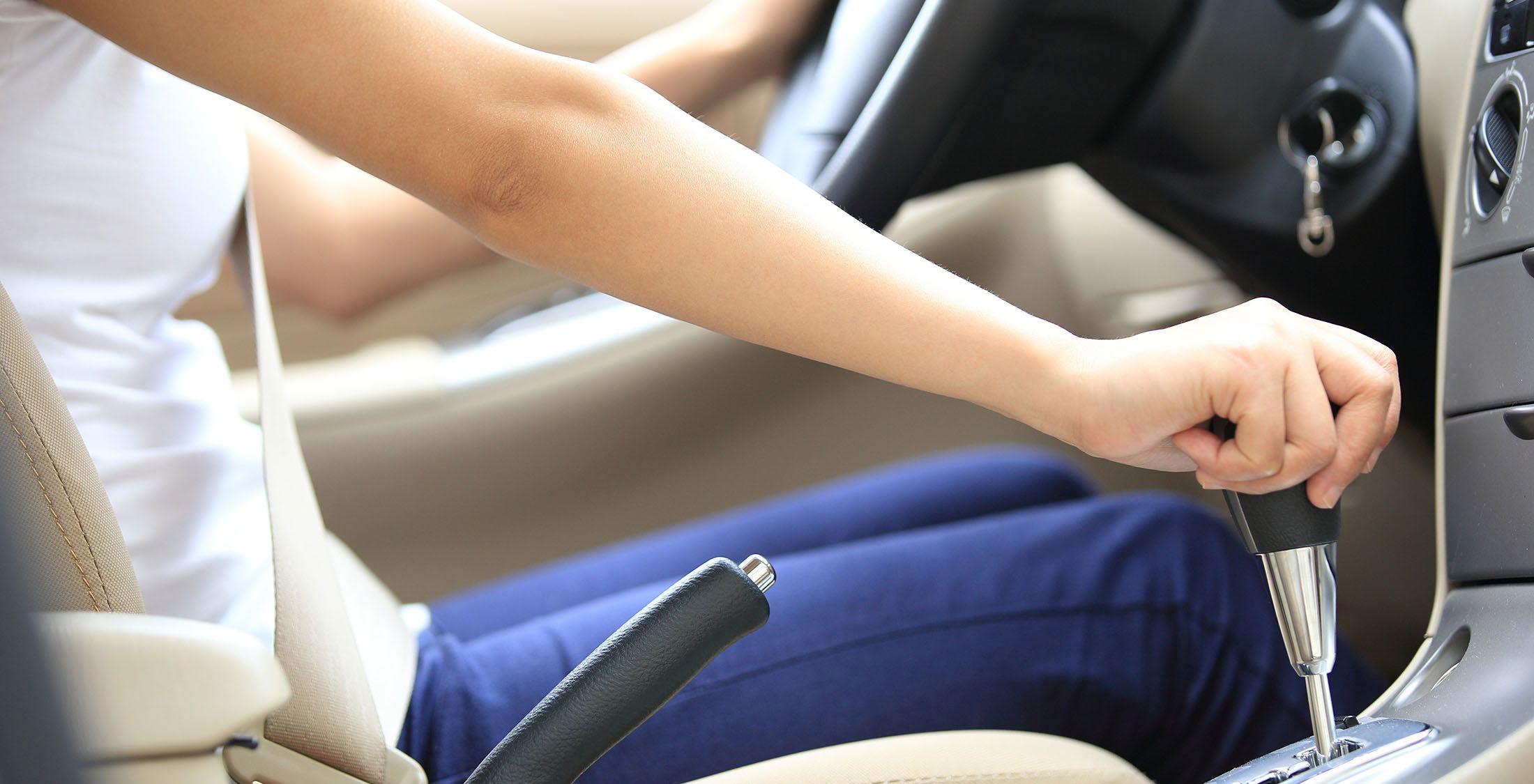 woman driving stick shift car