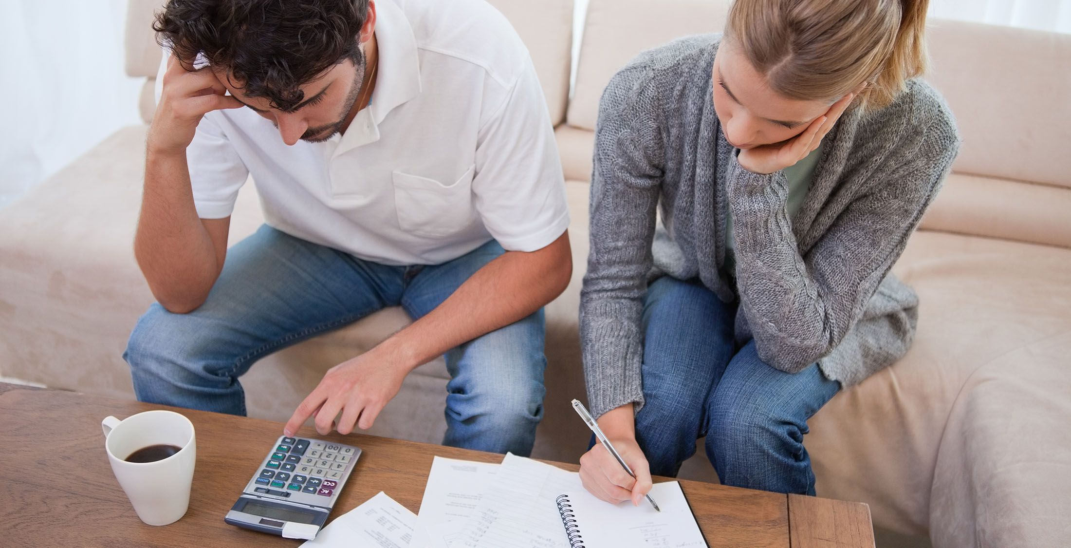 stressed couple trying to budget