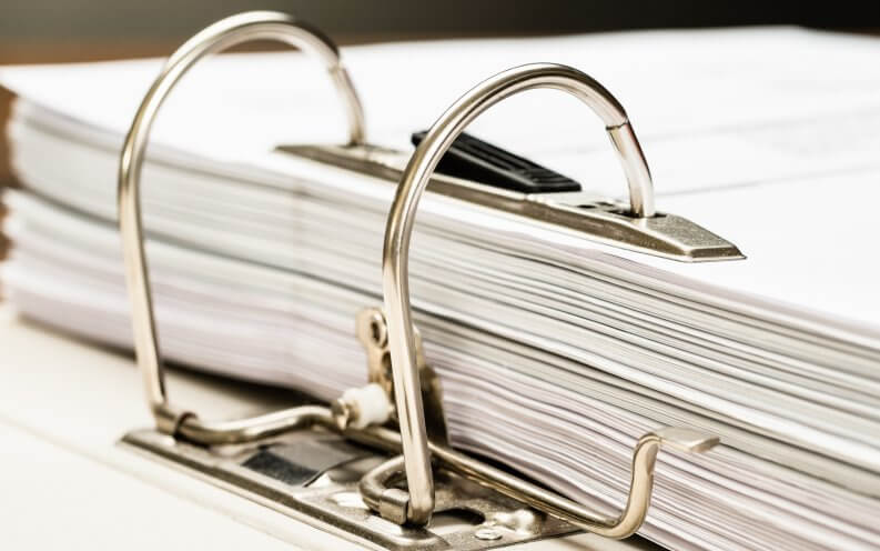 stack of paper in binder