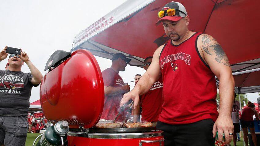 GLENDALE, AZ - SEPTEMBER 13: Shawn Cooper of Avondale, AZ grills before the start of the NFL game between the Arizona Cardinals and the New Orleans Saints at the University of Phoenix Stadium on September 13, 2015 in Glendale, Arizona.