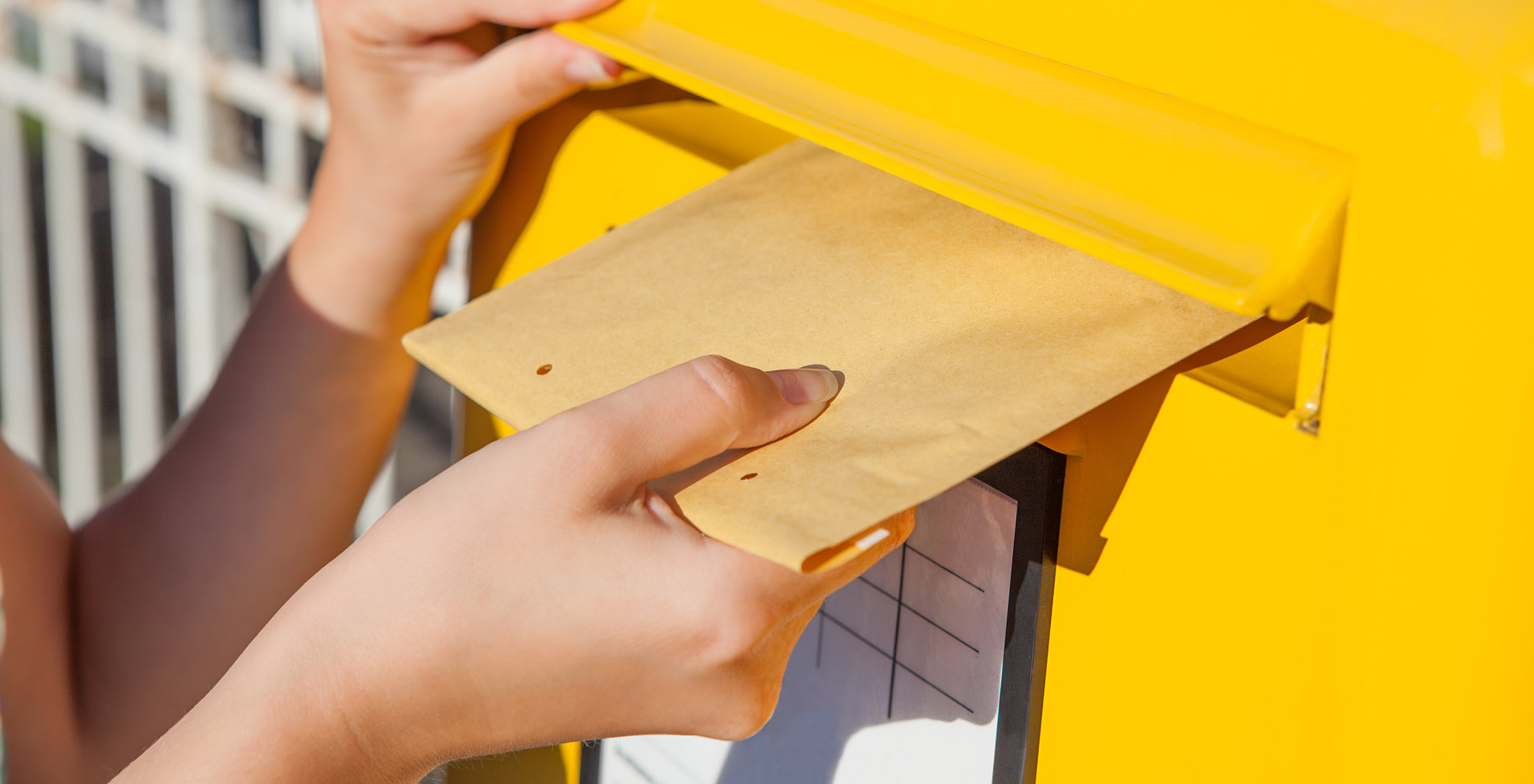 place envelope into mail slot