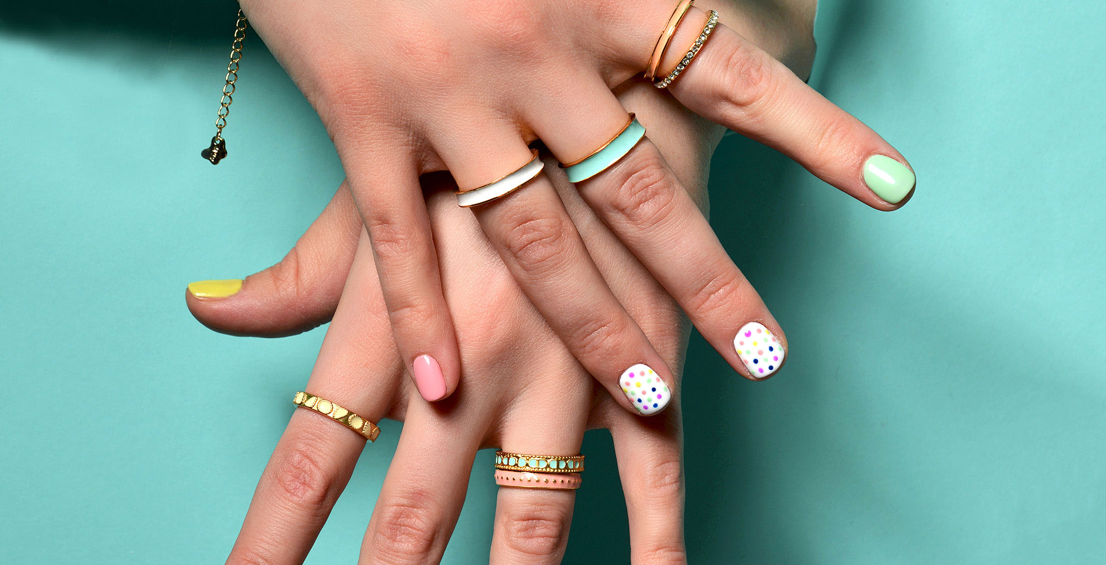 women's hands with different color rings