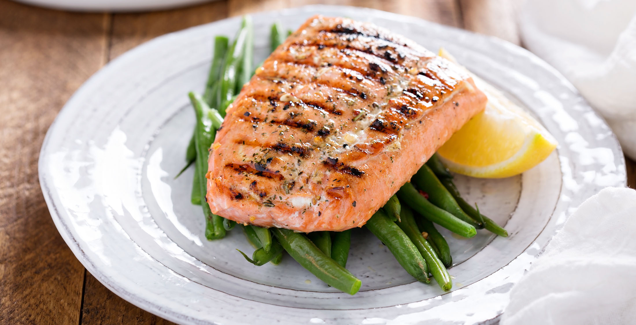 grilled salmon on green beans with lemon
