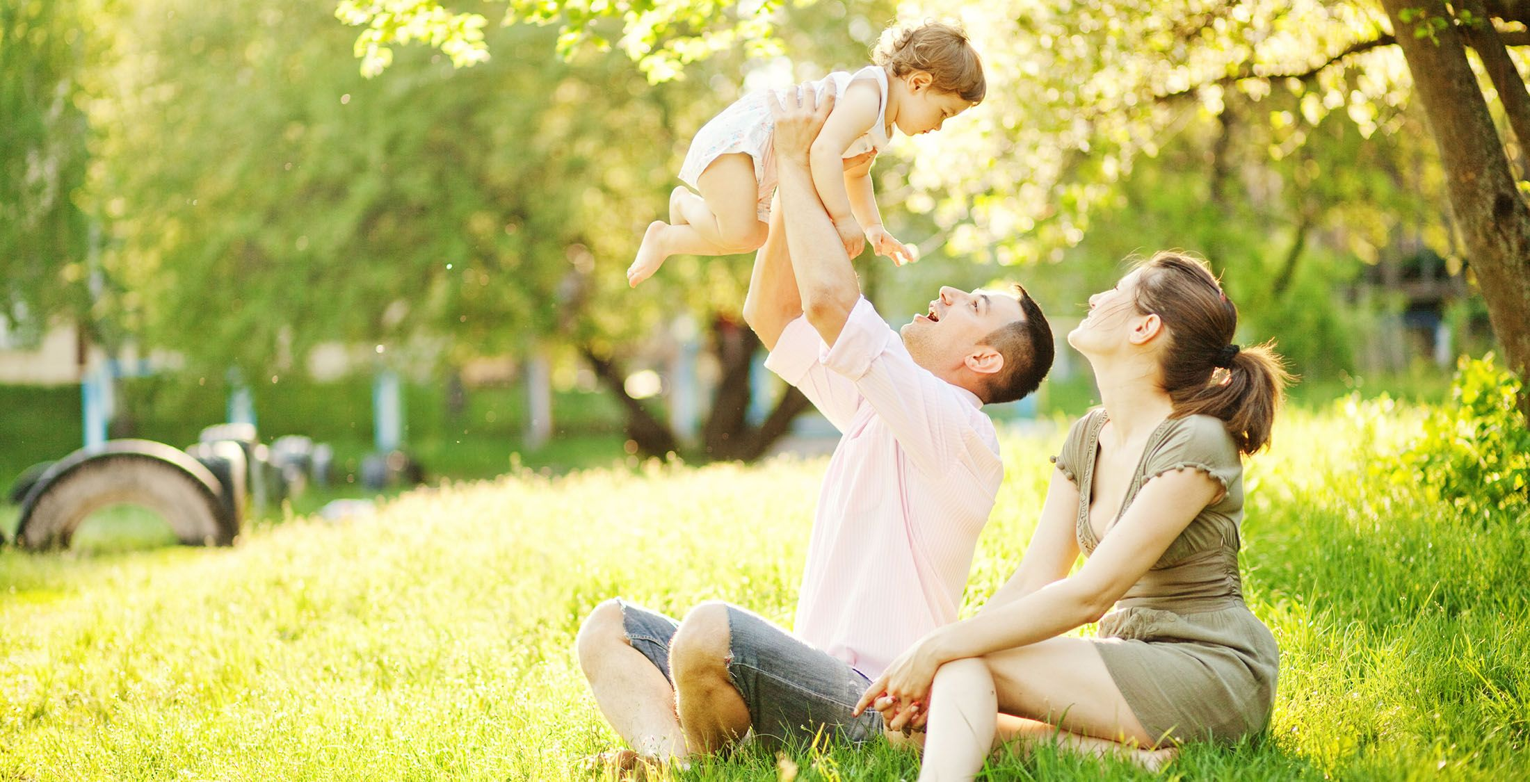 couple playing with baby