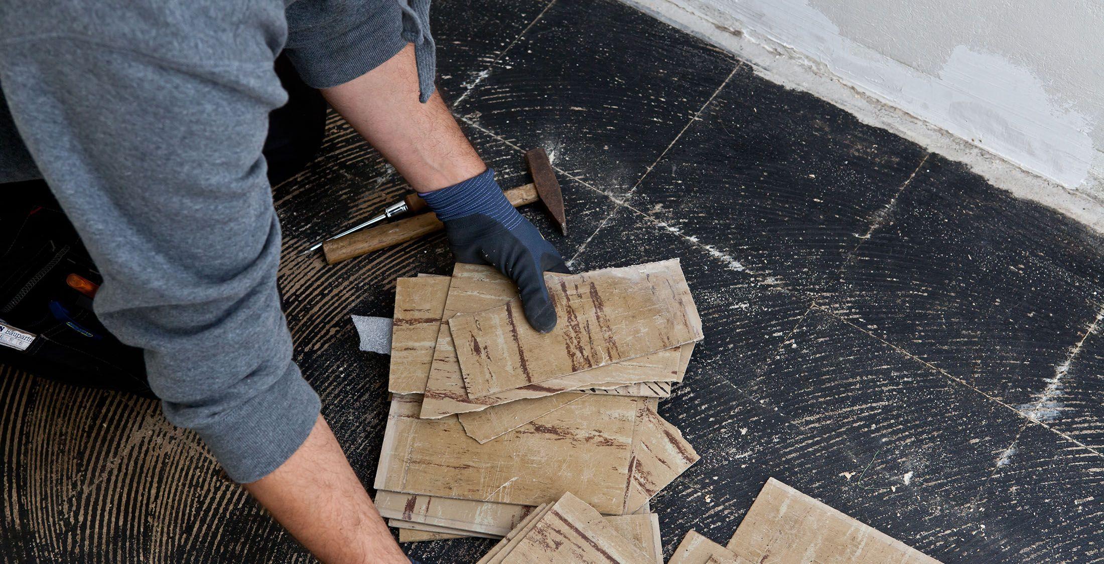 construction worker renovating flooring