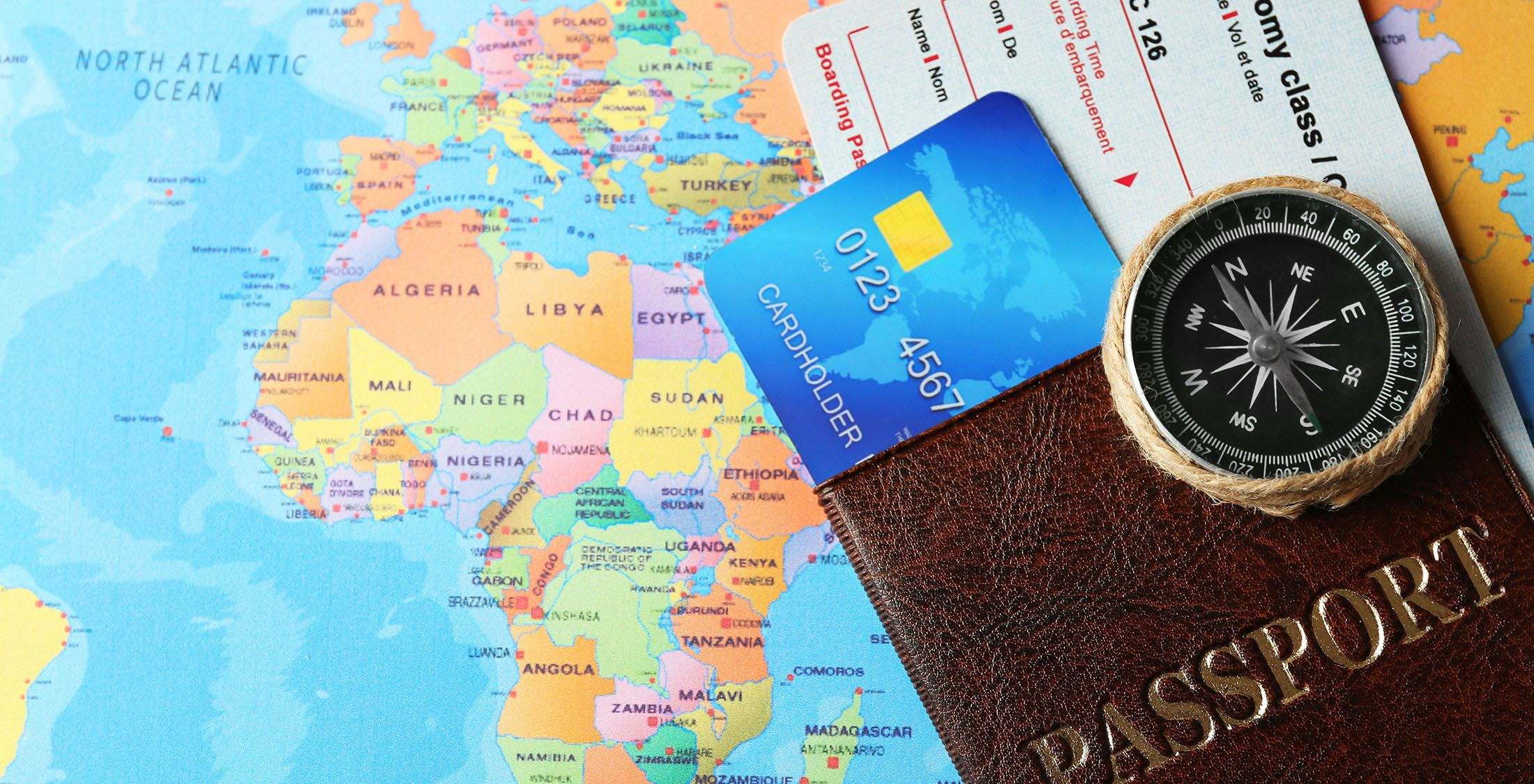 passport on top of map