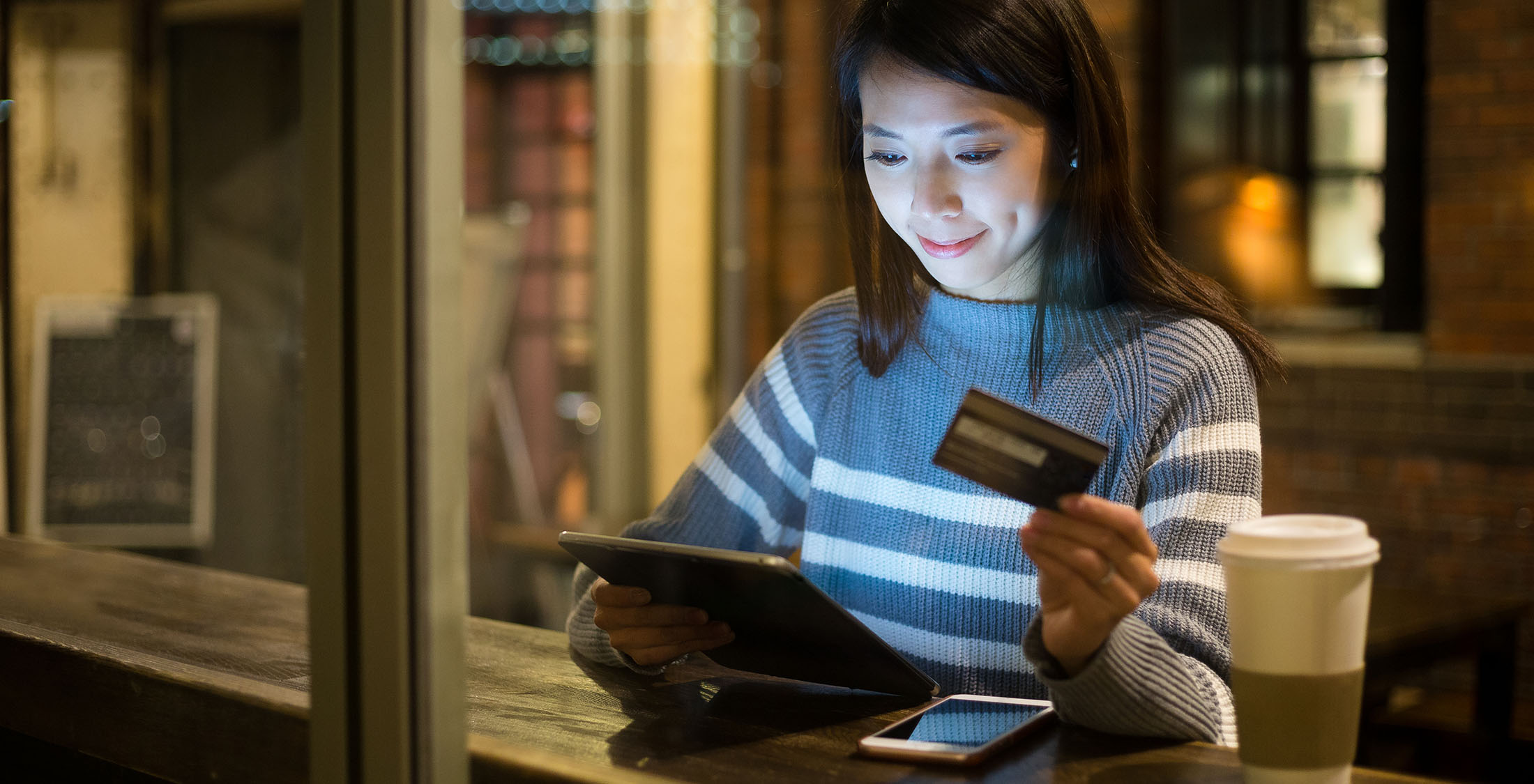woman with ipad and credit card