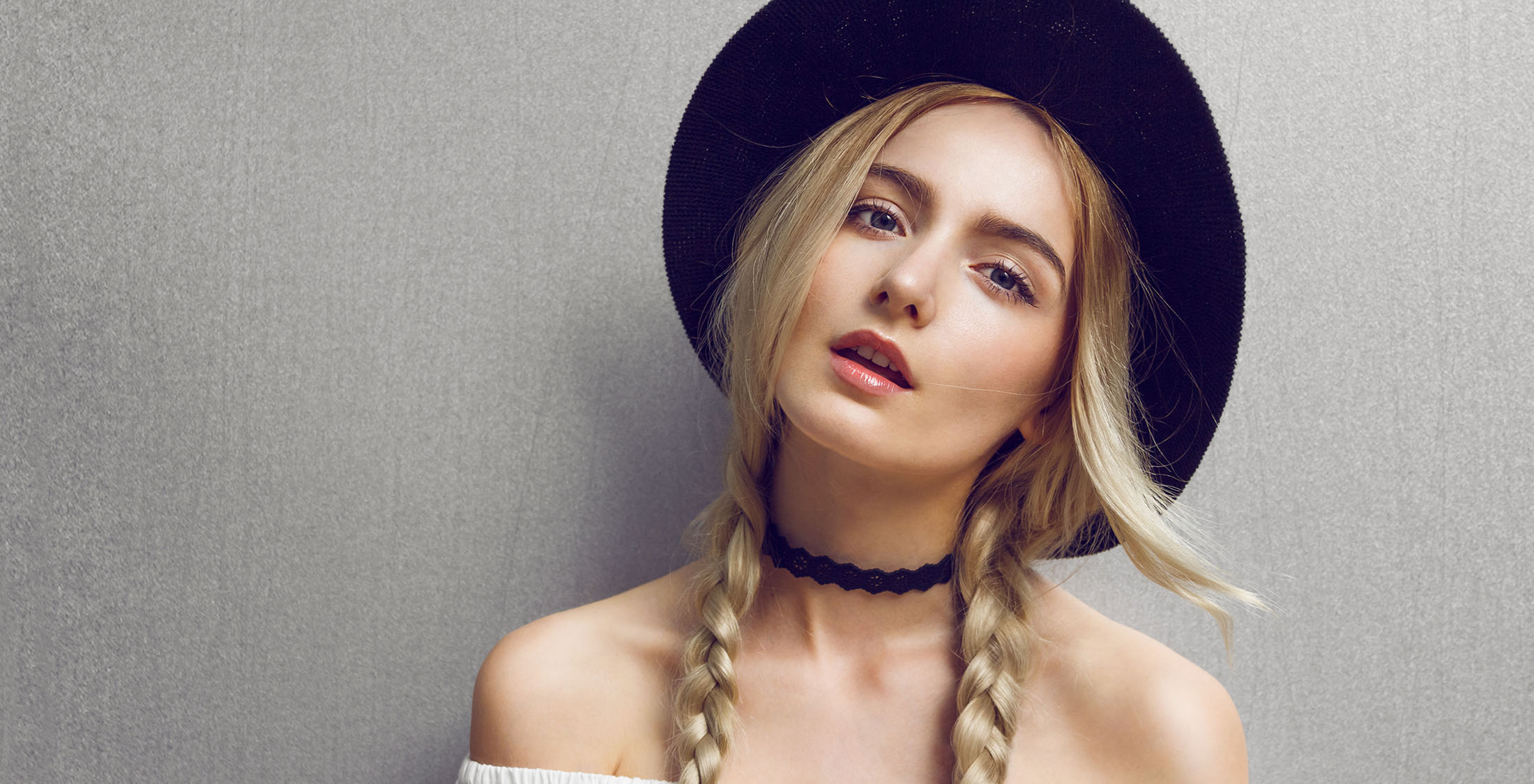 woman with black hat and choker necklace