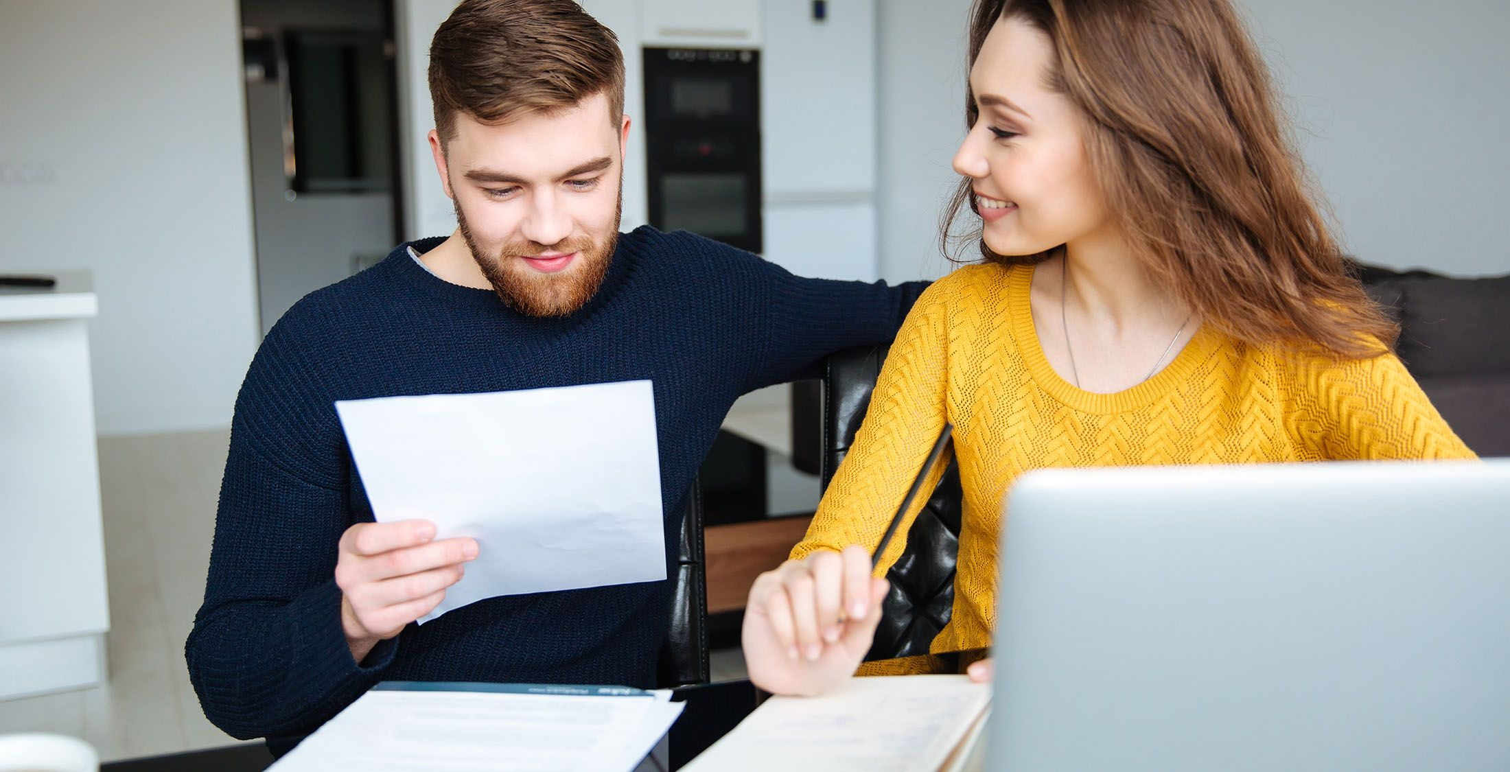 man looking over bills with woman