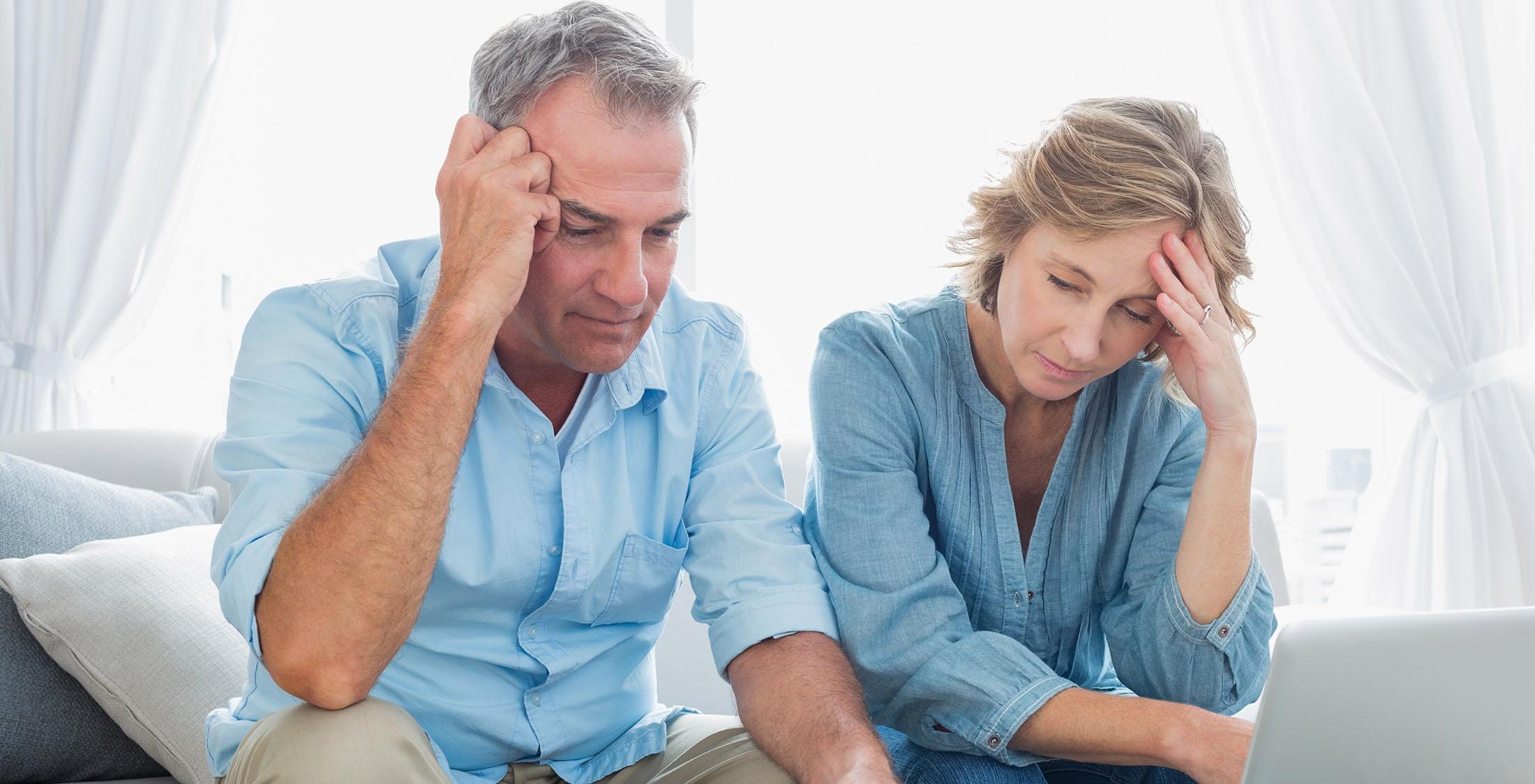 elder couple looking stressed