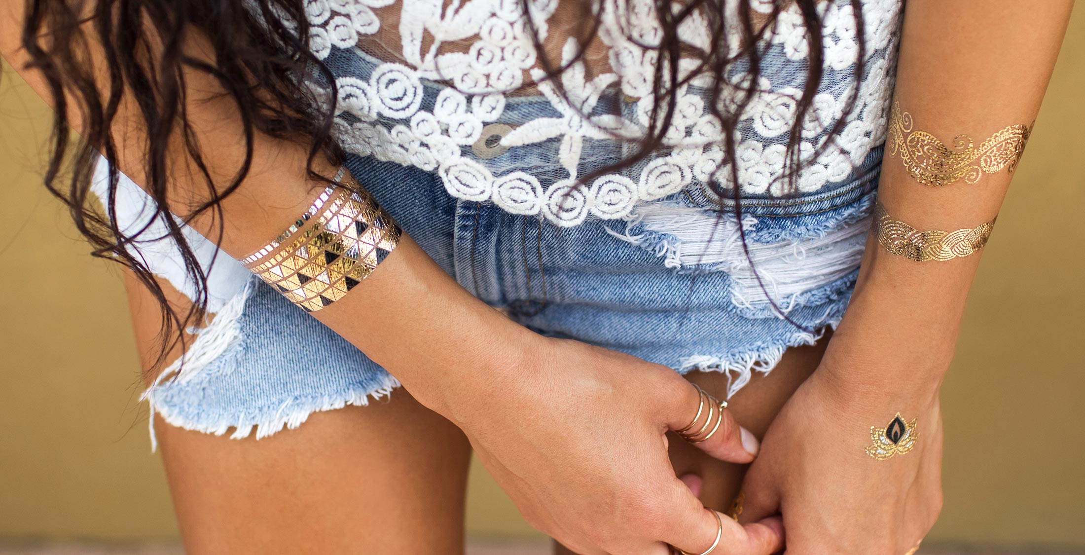 woman with flash jewelry on arms and hand