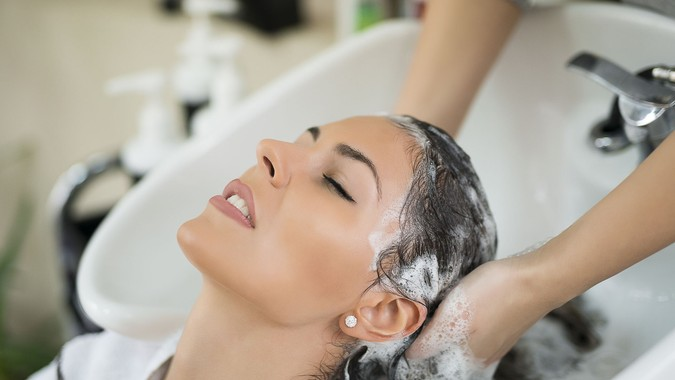 woman getting hair washed at salon