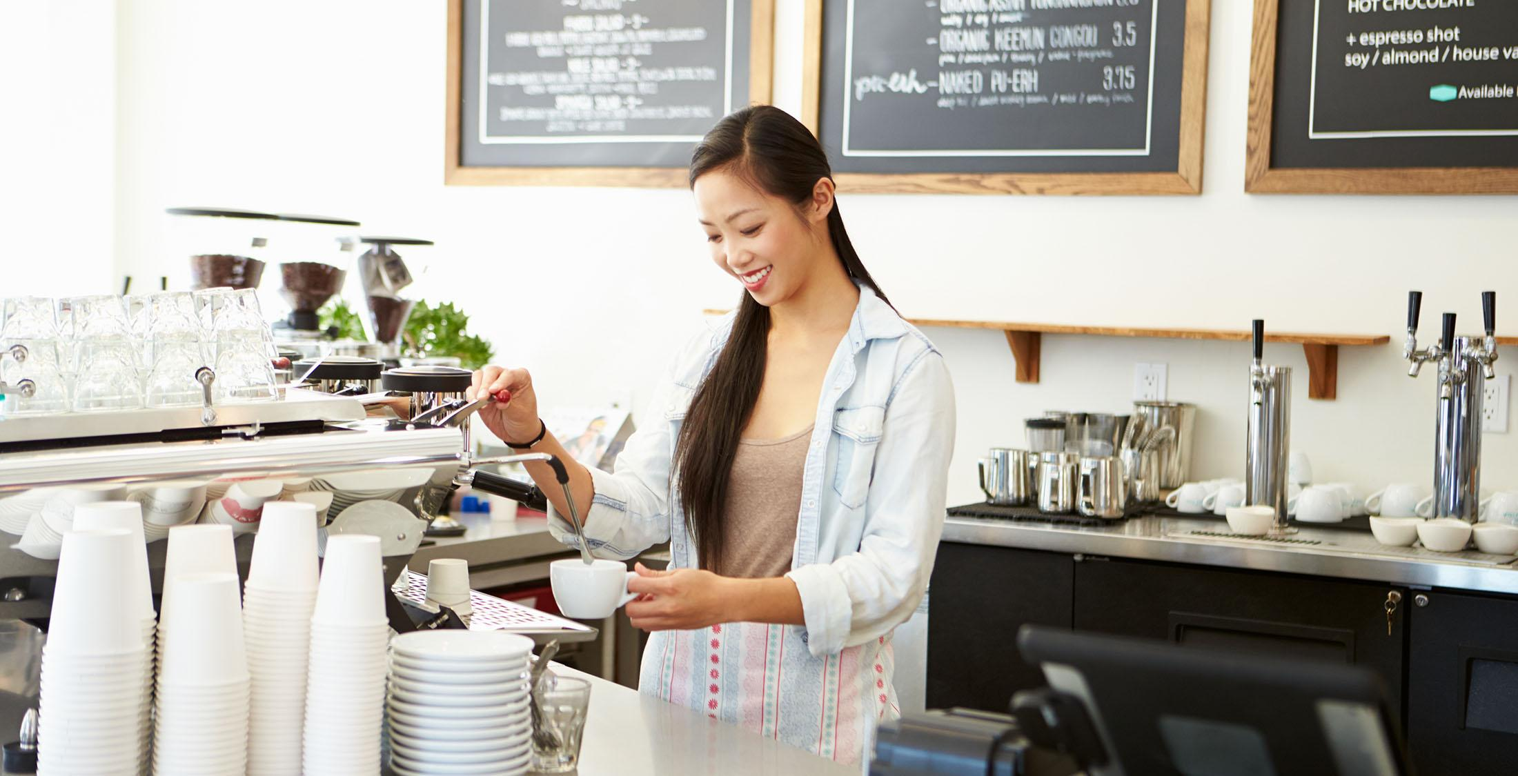 barista making an espresso