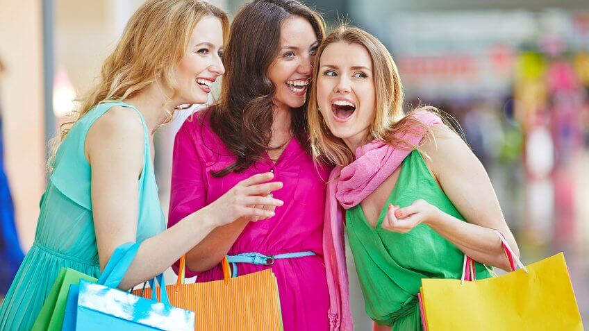 woman laughing and shopping