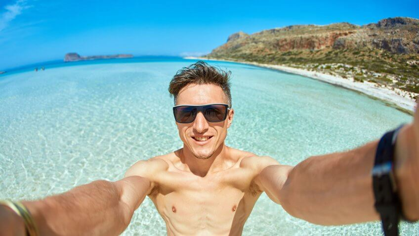 man taking selfie on the beach