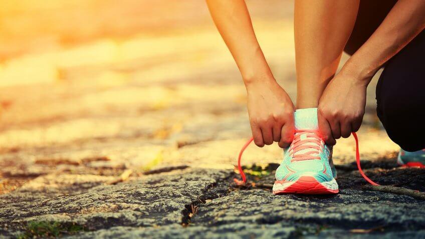 runner tying on running shoes