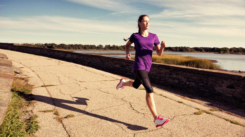 A female runner runs in New England.